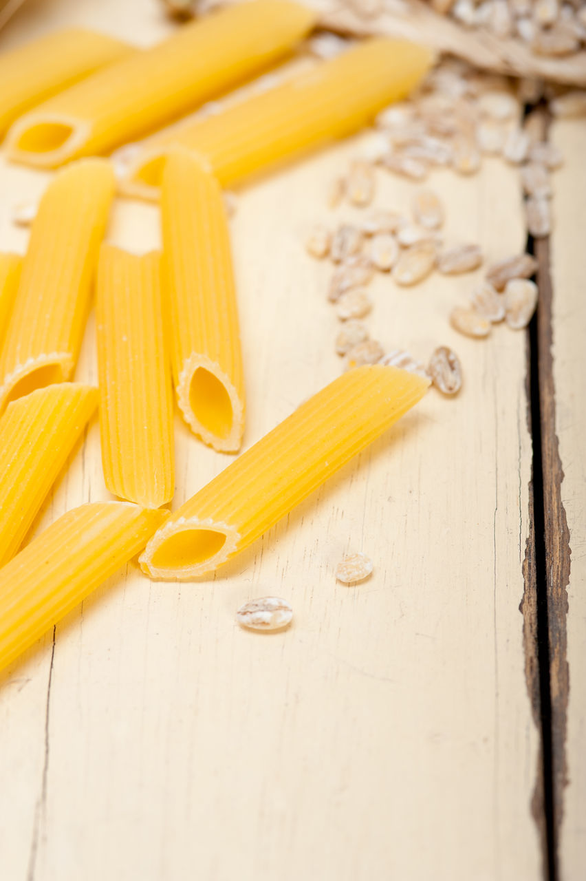 pasta, italian food, food and drink, raw food, spaghetti, freshness, food, indoors, healthy eating, close-up, yellow, still life, table, wood - material, preparation, no people, wheat