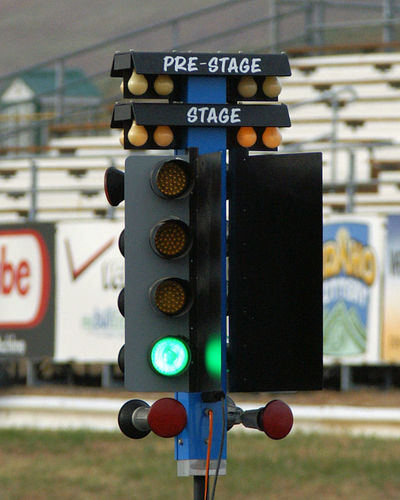 Close-up Communication Day Direction Drag Racing Focus On Foreground Go Fast Guidance No People Outdoors Race Tree Road Sign Sky Stoplight Street Lights