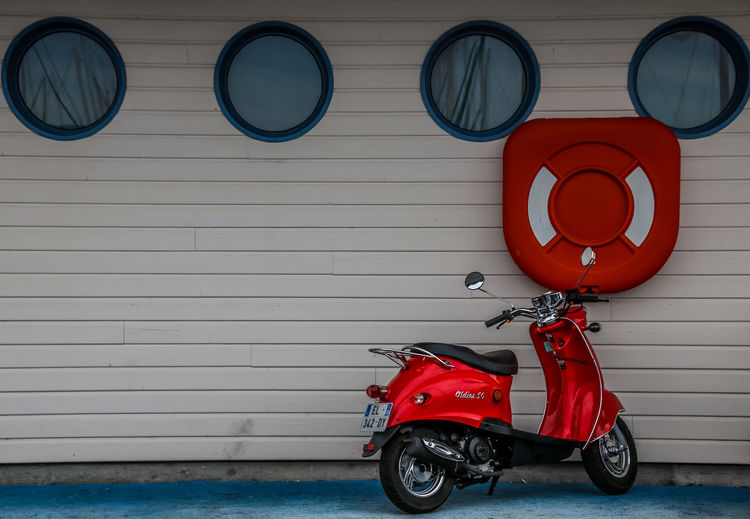 Colored Colors Red Architecture Built Structure Day Land Vehicle Lifebuoy Mode Of Transport No People Outdoors Red Scooter Stationary Transportation The Week On EyeEm