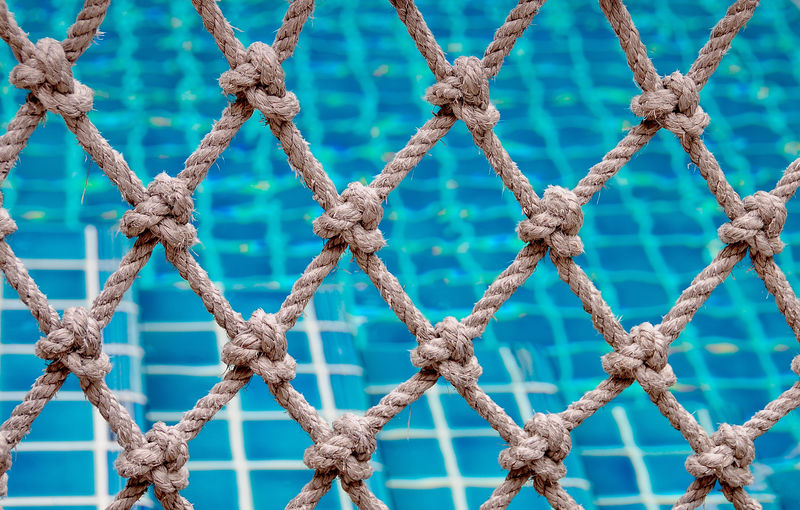 Rope fence against swimming pool
