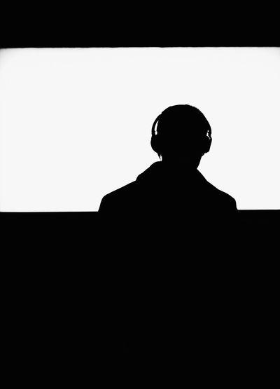 Silhouette man against clear sky