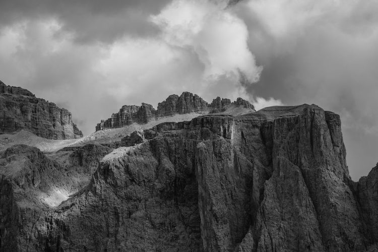 Sella The Great Outdoors - 2019 EyeEm Awards Atmospheric Mood Overcast Dramatic Sky Storm Storm Cloud Cloud - Sky Sky Power In Nature Mountain Tree Mountains Mountain Peak EyeEm Nature Lover Dramatic Lighting Spectacular Majestic Natural Landmark Mountain View Alpine Landscape Alps Alpen Südtirol Dolomites Dramatic Landscape Monochrome Blackandwhite Betterlandscapes Beauty In Nature Landscape Paysages Grys