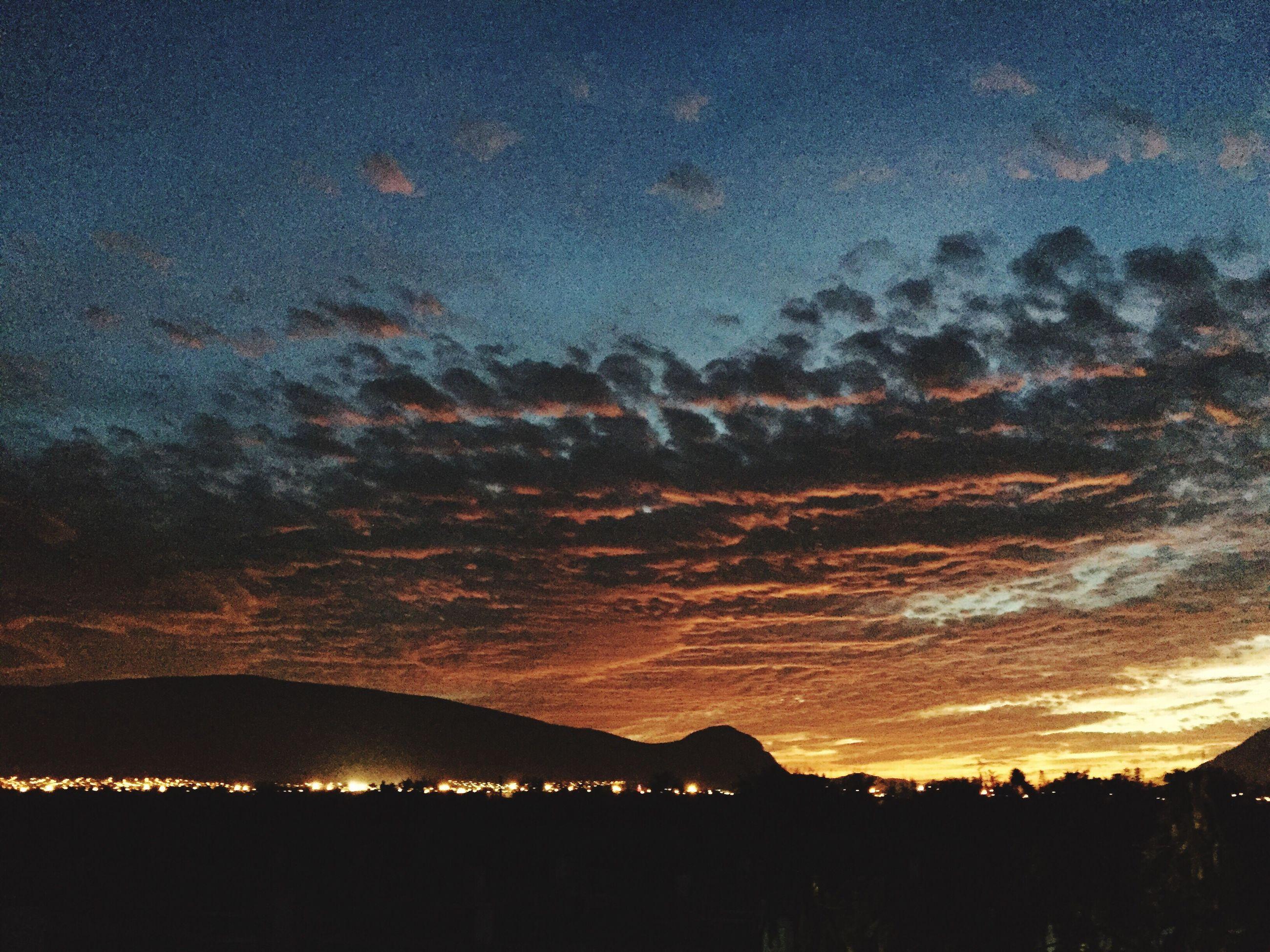 sunset, scenics, silhouette, sky, beauty in nature, tranquil scene, tranquility, nature, landscape, idyllic, dusk, orange color, cloud - sky, dark, illuminated, dramatic sky, night, mountain, majestic, outdoors