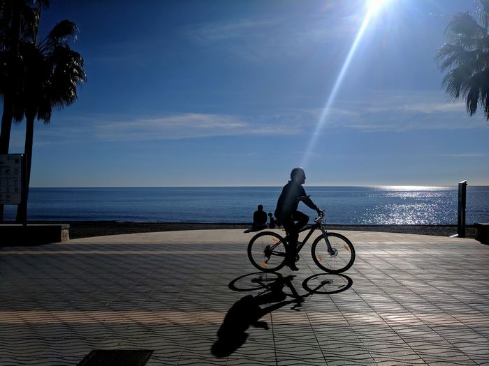Spin Bike EyeEm Ready   Beach Bike Ride Silhouette Shadow Shadows Winter Sun Bicycle Sea One Person Sky Outdoors Full Length One Man Only Beach Horizon Over Water Adult Tree Cycling Scenics