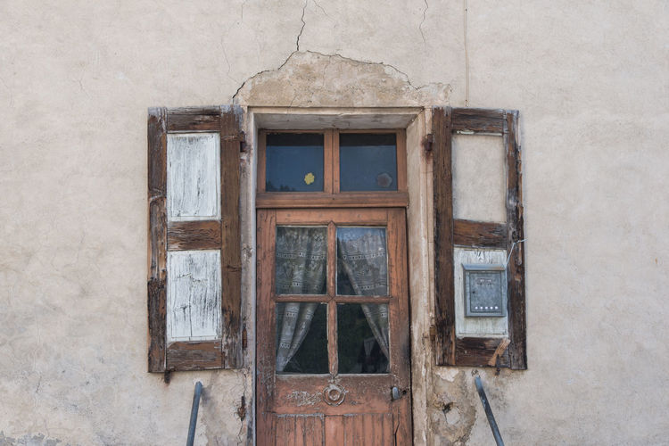 Old wooden weathered door. exterior of old building