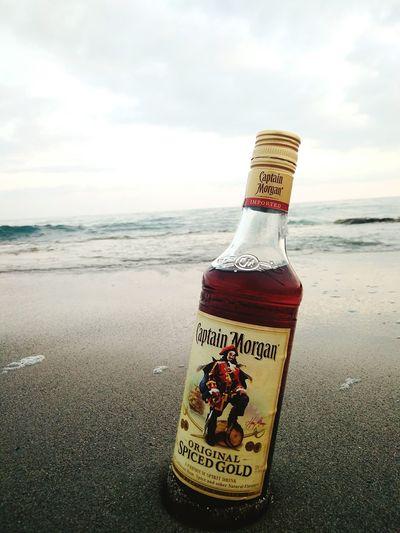 Capitan Morgan Capitan Alcohol Drinking Water Sea Beach Sand Communication Bottle Text Safety Danger Warning Sign Single Word