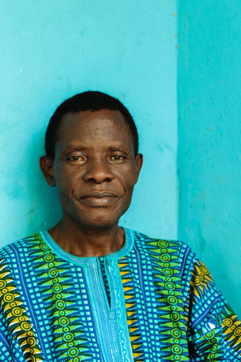 Nigeria Travel Adult Blue Front View Headshot Humble Looking At Camera One Man Only One Person Only Men People Portrait
