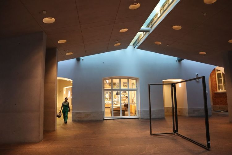 Architecture Indoors  One Person Walking Illuminated Ceiling Built Structure Real People Building Entrance Full Length Men Flooring Lifestyles Day Standing Window Casual Clothing Door Luxury