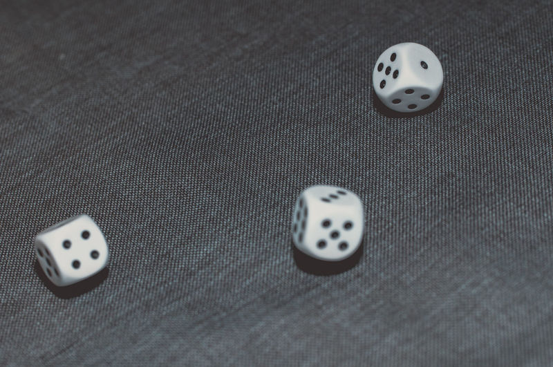 Close-up of dice on fabric