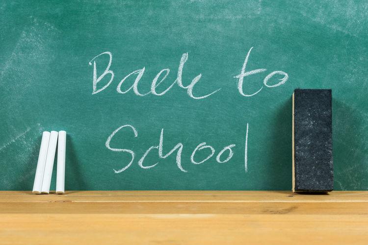Back To School Text On Blackboard In Classroom