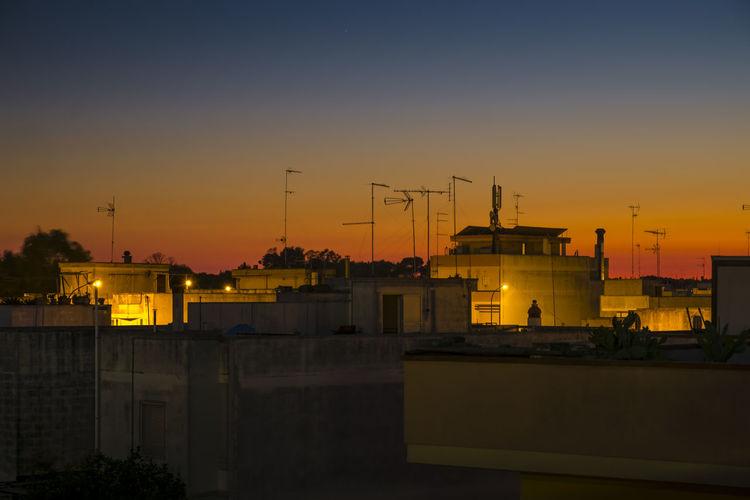 Illuminated Buildings During Sunset