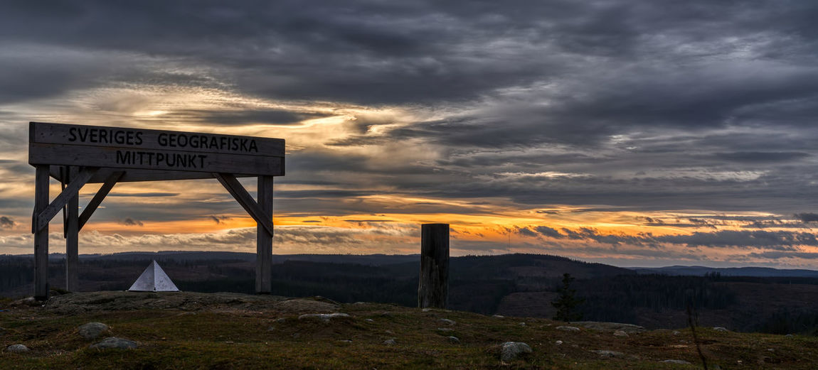 Geographical centre of Sweden. Cloud - Sky Text Sign Sky Communication Nature Western Script No People Sunset Land Tranquil Scene Tranquility Information Landscape Sign Geographical Centre Clouds Nature Nature_collection Nature Photography Olympus OM-D E-M10 Mark II