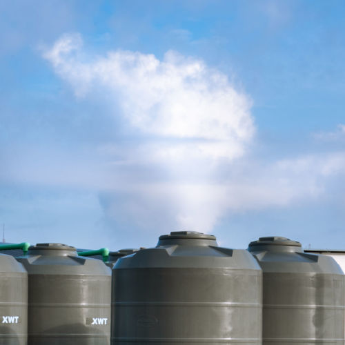 Low angle view of bottles against sky