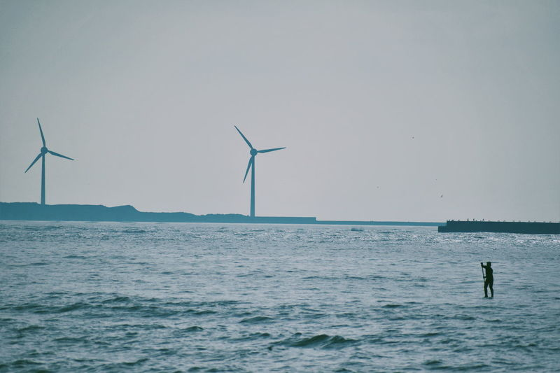 Calm Channel France Nature Windmill Adventure Beauty In Nature Clear Sky Horizon Horizon Over Water Lifestyles Ocean One Person Outdoors Paddle Paddleboarding Power In Nature Sea Sky Sport Turbine Water Waterfront Wind Power Wind Turbine This Is Strength My Best Photo