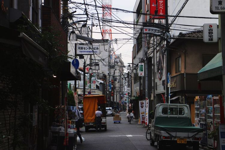 Osaka,Japan Architecture Built Structure Building Exterior City Street Land Vehicle Cable Transportation Outdoors Mode Of Transport Day Car No People Sky