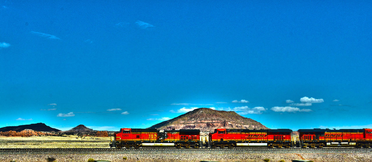 A Long Way to Go Arizona Blue Blue Sky Cargo Choo Choo Choo Choo Train Colorful Colorfull Forward Going Forward  Hills Locomotive Mountain View Mountains Moving Orange Peaceful Pull Red Senic The Path Ahead Tracks Train The Photojournalist - 2016 EyeEm Awards Yellow