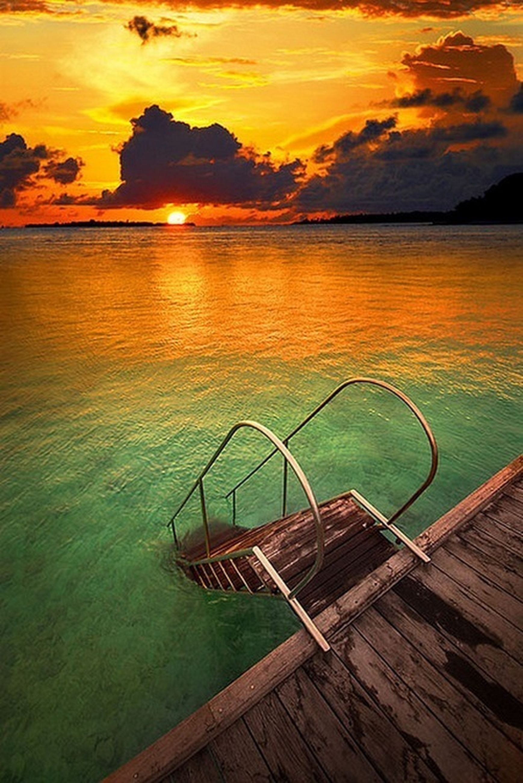 water, sunset, sky, sea, scenics, tranquility, tranquil scene, beauty in nature, cloud - sky, nature, horizon over water, idyllic, reflection, orange color, cloud, pier, beach, shore, wood - material, outdoors