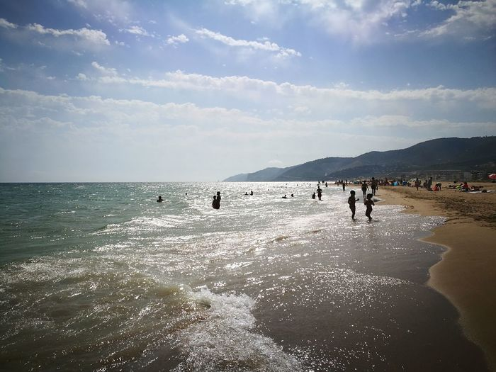Beach Sea Sand Water Nature Sky Beauty In Nature Vacations Outdoors Horizon Over Water Summer People Day Landscape Scenics Large Group Of People Swimming Adult Adults Only Barcelona