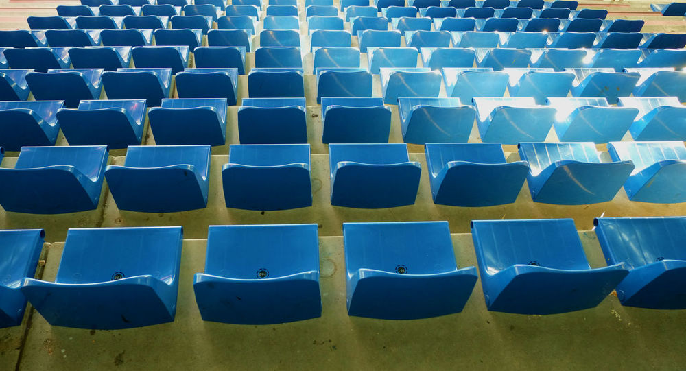 Choose your blue Blue Monday BYOPaper! Chair Day Empty Folding Chair From My Point Of View Full Frame High Angle View In A Row Indoors  Is This Seat Taken? Large Group Of Objects No People Plastic Repetition Seat Shadows & Lights Stadium Things Organized Neatly