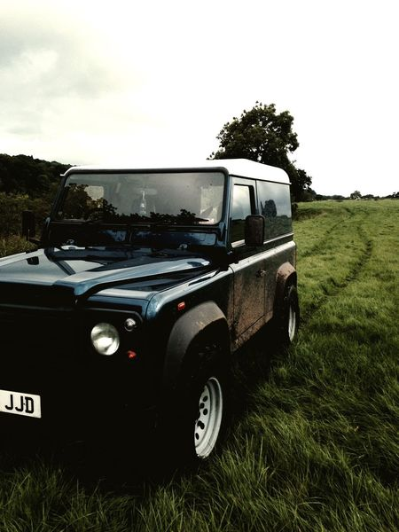 Car Mode Of Transport Transportation Land Vehicle Stationary Travel Parking Landscape Side View Grass Pick-up Truck Dirt Road Day 4x4 Growth Sky Motor Vehicle Parked Outdoors Van EyeEm Gallery Getty Images End Of Summer Landrover  Defender