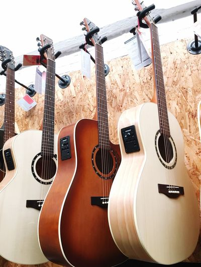White and Brown Acoustic guitars exposition Wood Music Instrument Musical Instruments Store Wood Instruments Chord Instruments Music Instrument Acoustic Guitars Guitars Guitarstrings Acoustic Brown Guitar Acoustic White Guitar Guitars Acoustic Guitar Guitar String Instrument Musical Instrument Musical Equipment Music Musical Instrument String No People String Arts Culture And Entertainment Acoustic Guitar Electric Guitar Indoors  Woodwind Instrument Arrangement Still Life Wall - Building Feature Wind Instrument Side By Side