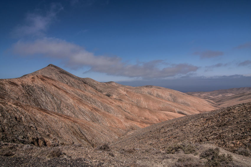 Fuerteventura Arid Climate Beauty In Nature Day Desert Geology Kanarische Inseln Landscape Mountain Mountain Range Nature No People Outdoors Physical Geography Scenics Sky Tranquil Scene Tranquility