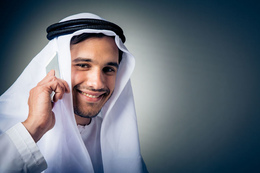 Arabian Black Background Fashion Happy Studio Tradition Traditional Clothing Arab Arabic Face Fashion Model Human Face Men One Person People Portrait Real People Smiling Studio Shot Traditional White Clothes
