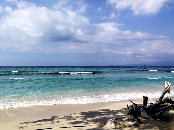 Gili Trawangan, Lombok, Indonesia Beach Sand Sea Horizon Over Water Vacations Cloud - Sky Tropical Climate Wave Water Sky Nature Travel Destinations Idyllic Tourism Sunny Tranquility Tranquil Scene Scenics Water's Edge Beauty In Nature