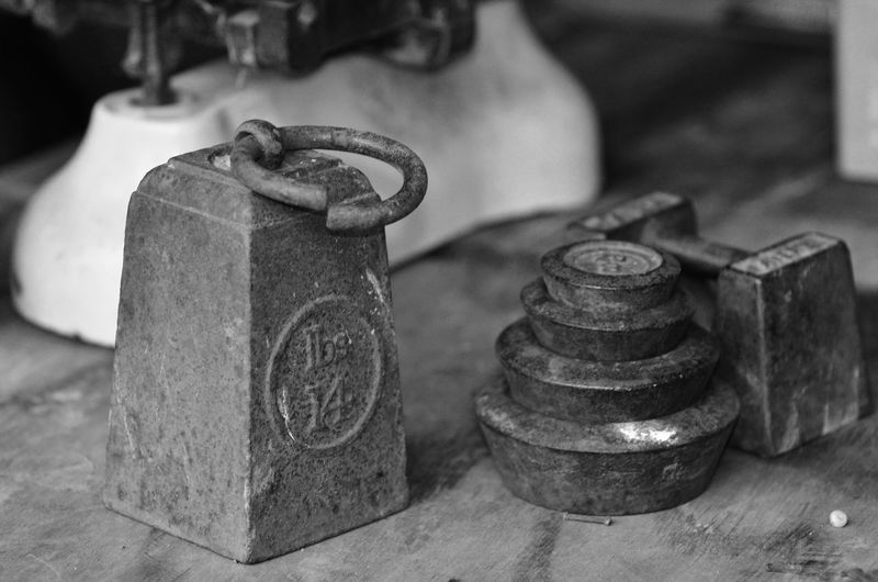 Old-fashioned weights on wooden plank