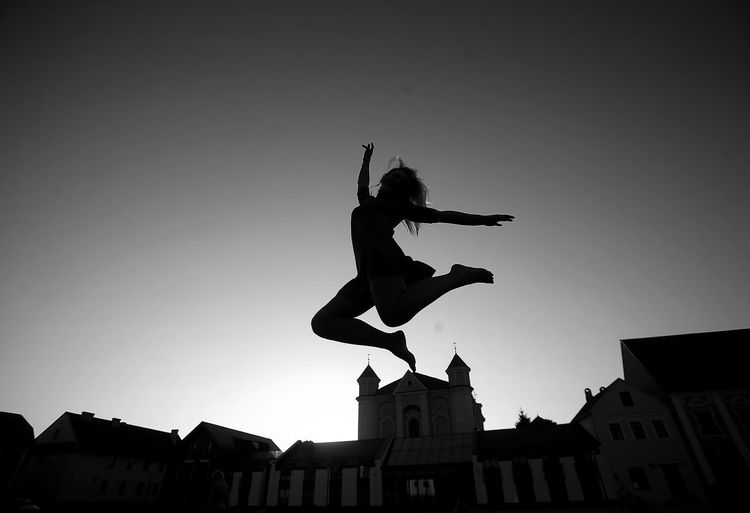Kedainiai Old Town Lithuania Architecture Building Building Exterior Built Structure City Clear Sky Day Extreme Sports Full Length Human Arm Human Representation Jumping Mid-air Nature One Person Outdoors Representation Silhouette Sky Sports Women Young Adult Young Women