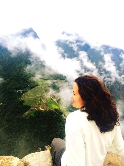 Letting Go Young Women Sky Nature Headshot Outdoors Beauty In Nature Cloud - Sky Inca Ruins Cloud Clouds And Sky Clouds Mountain Range Mountains Mountain View Mystic Mystical Atmosphere Mystical Wild Hair Curls Young Adult One Person Women Scenics Beautiful Woman