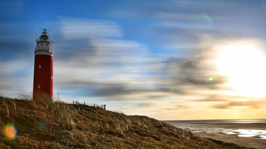 Texel - Holland Lighthouse Beach Sea Protection Safety Sunset Water Horizon Over Water Sky Nature No People Tranquility Red Outdoors Cloud - Sky Architecture