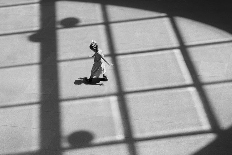 Shadow of man with umbrella