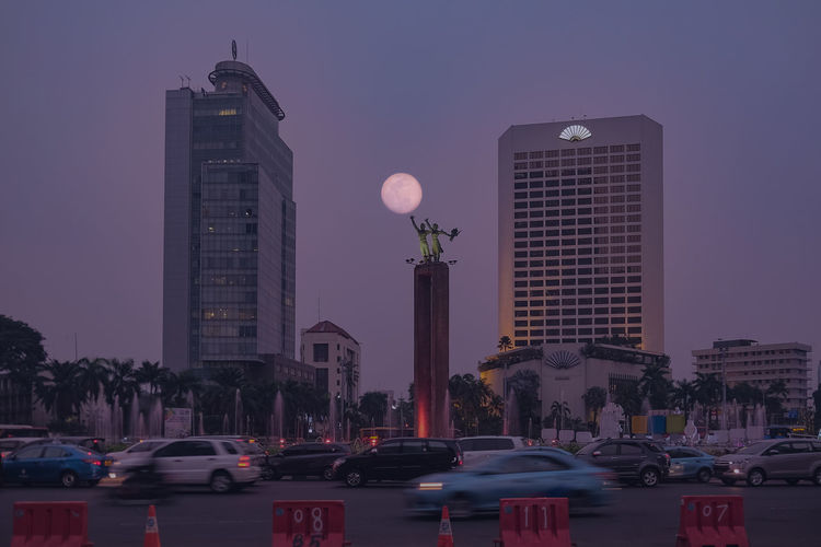 Architecture Building Building Exterior Built Structure Car City Dusk Land Vehicle Mode Of Transportation Modern Moonrise Motor Vehicle Nature No People Office Building Exterior Outdoors Purple Sky Skyscraper Street Supermoon Tall - High Tower Transportation Travel Destinations