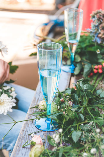 Flower Wreath Glass Drink Refreshment Food And Drink Alcohol Table Drinking Glass Wine Wineglass Household Equipment Champagne Flute Day Freshness Nature Plant Glass - Material Focus On Foreground Transparent Champagne Outdoors