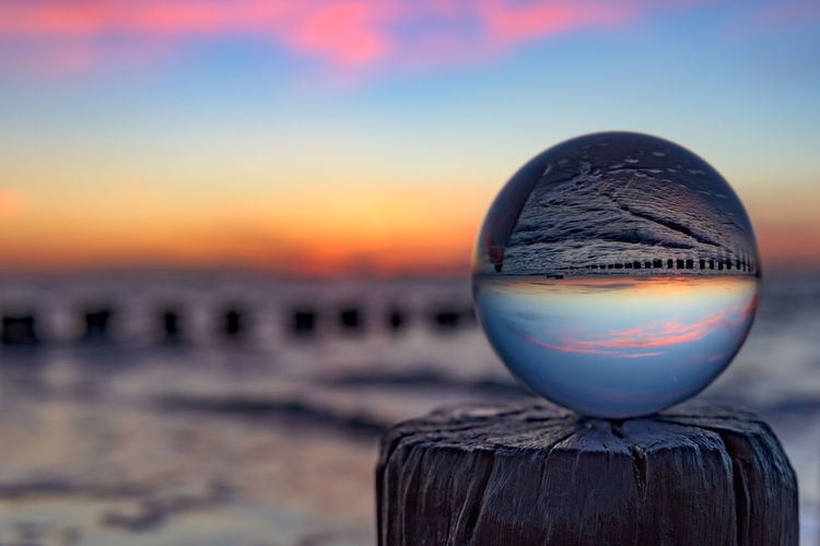 "Sunset with a glass sphere (Nikon D810 24-70mm f/2.8 ƒ/3.2 36mm 1/160"" iso 100) Beach Beauty In Nature Close-up Colorful Focus On Foreground Glass Idyllic Landscape Majestic Nature Nikon No People Non-urban Scene Orange Color Outdoors Scenics Selective Focus Sphere Sun Sunset Tranquil Scene Tranquility Www.benjaminvanderspek.com Showcase April"