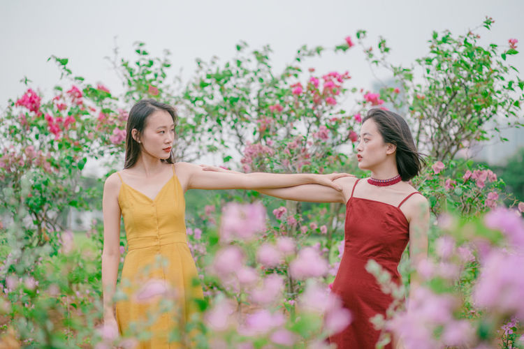 Pastel Pastel Power Pastel Colors Flowers Garden Portrait Photography Portrait Of A Woman Female Girl Power Flower Child Friendship Tree Smiling Beauty Togetherness Girls Females Standing In Bloom Blooming Botany This Is Natural Beauty The Week On EyeEm Editor's Picks
