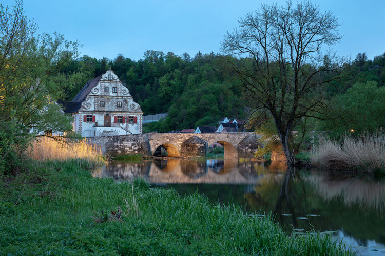 Harburg is a city along the romatic road in Bavaria in the valley of river Wörnitz. Bavaria Bayern Deutschland Germany Harburg In Schwaben Plant Tree Built Structure Architecture Water Building Exterior Building Nature No People Grass Lake Reflection Sky Growth Day House Land Outdoors Harburg Bridge Historic Historical Building Blue Hour Illuminated Green Color Wörnitz
