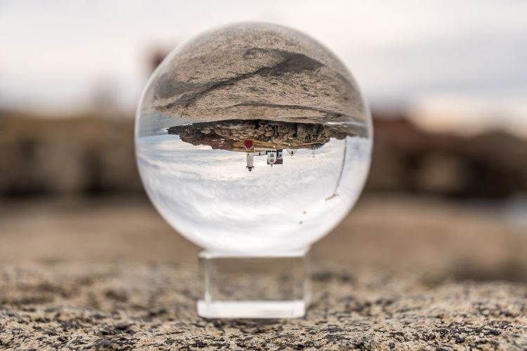 Nubble lighthouse through lensball Crystal Ball Lighthouse Nubble Light Lensball EyeEm Selects Focus On Foreground Close-up No People Insect Outdoors Nature Day