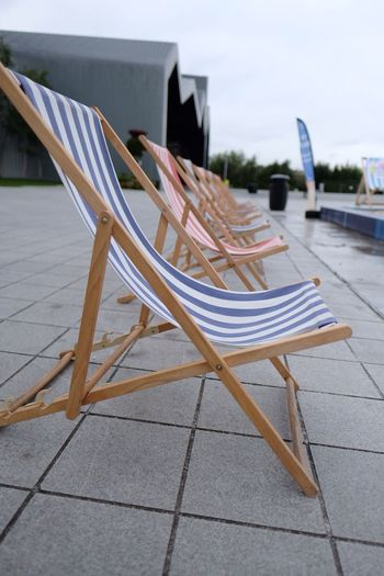 EyeEm Selects Chair Absence No People Table Furniture Empty Folding Chair Sun Lounger Group Of Objects Focus On Foreground Outdoors Seat Day Nature Close-up Sky Riverside Museum