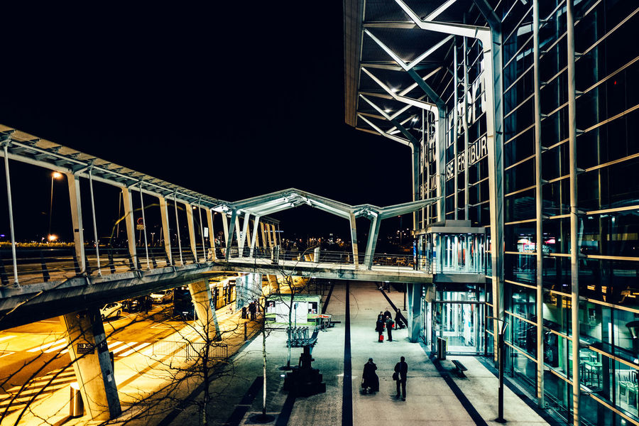 Airport Basel Arch Architecture Basel Mulhouse Bicycle Bridge - Man Made Structure Building Exterior Built Structure City City Life Connection Illuminated Incidental People Indoors  Lighting Equipment Men Night Railing Reflection Transportation Walking