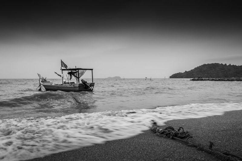 Boat moored near beach