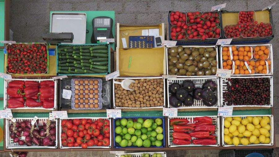 Directly above of fruits and vegetables for sale