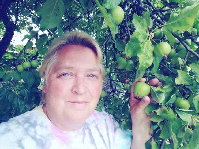 Selfie. Checking out the young green apples on our tree. Woman Female Happy Backyard Adult Lesbian Lgbt Tree Portrait Smiling Fruit Branch Happiness Healthy Lifestyle Looking At Camera Rural Scene Apple Tree Fruit Tree Apple Picking Harvesting Orchard