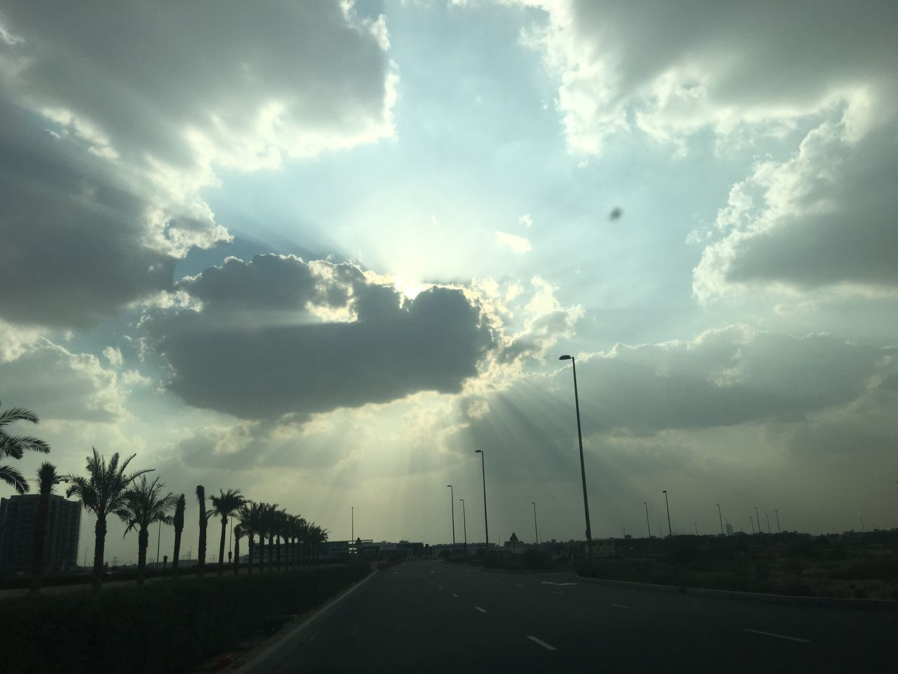 cloud - sky, road, sky, the way forward, transportation, outdoors, no people, tree, nature, scenics, day, storm cloud, beauty in nature