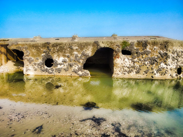 The broken remains of the a beetles, part of the floating roadways of the Mulberry Harbour, Normandy, France. Arromanches Clear Sky History Mulberry Harbour Normandy Normandy Beaches Tranquil Scene WWII WWII History