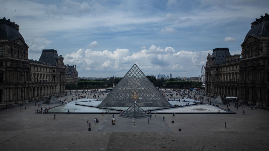 Louvre Architecture Building Building Exterior Built Structure City Cloud - Sky Day History Incidental People Nature Old Outdoors Sky The Past Tourism Travel Travel Destinations Triangle Shape