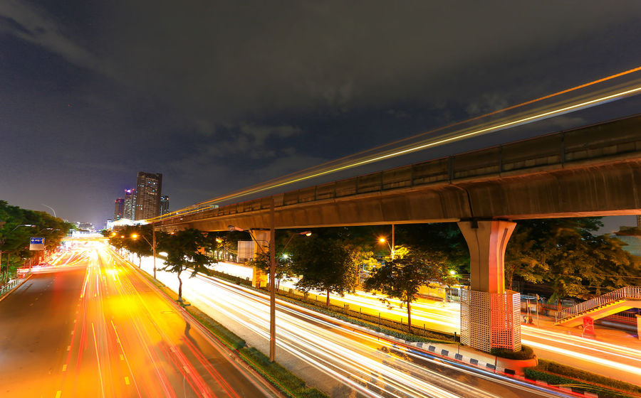 Architecture Blurred Motion Bridge - Man Made Structure Built Structure Car City City Life Connection High Street Illuminated Land Vehicle Light Trail Long Exposure Mode Of Transport Motion Night Outdoors Road Speed Street Street Light Traffic Train - Vehicle Transportation Vehicle Light