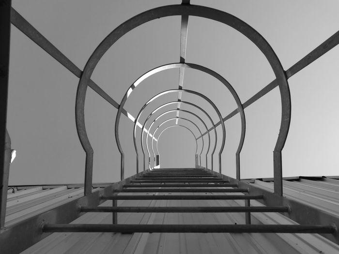 Corridor against clear sky