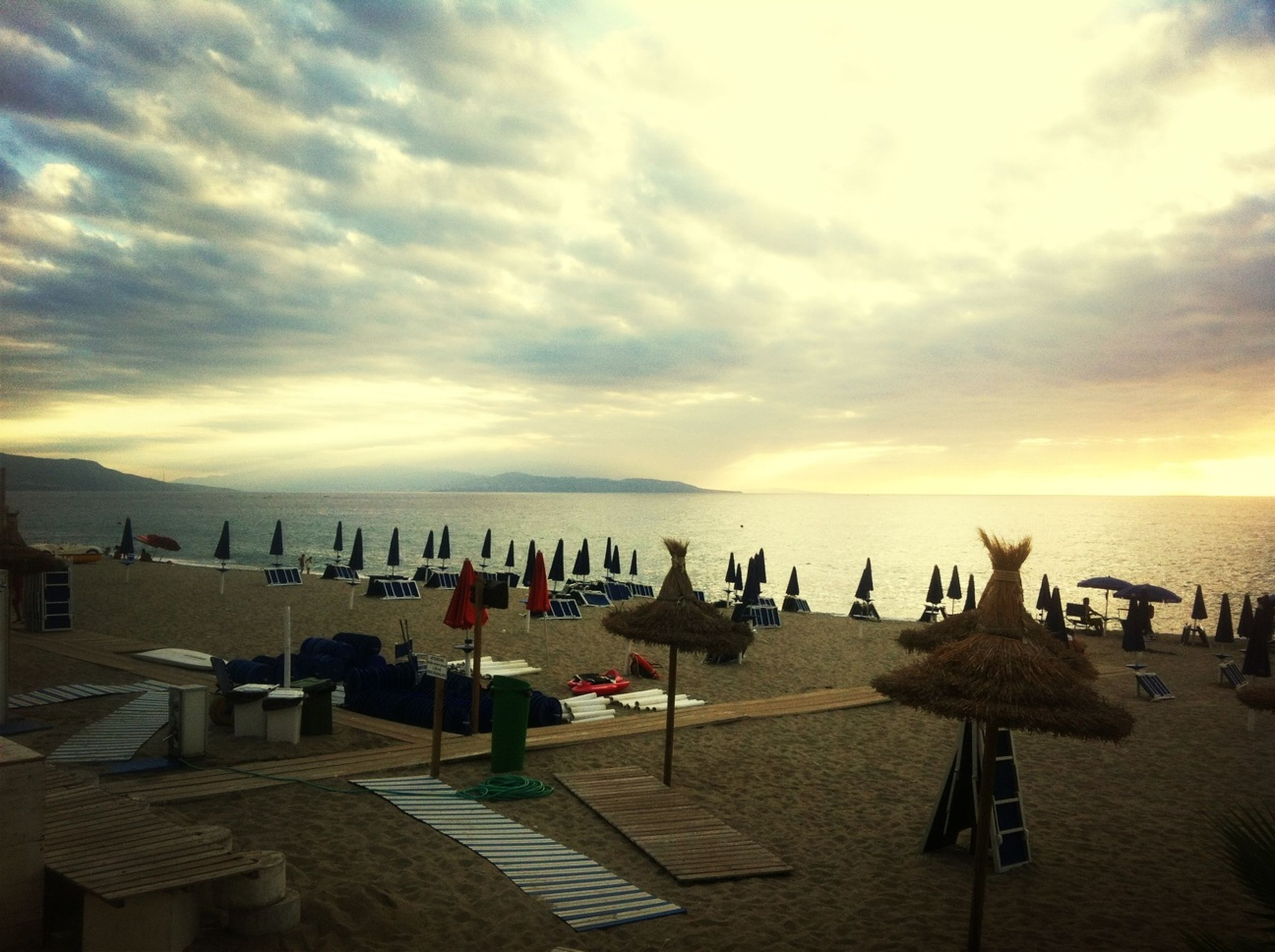sea, sky, beach, water, horizon over water, tranquil scene, cloud - sky, scenics, tranquility, sand, chair, shore, sunset, nature, beauty in nature, absence, empty, cloud, vacations, table